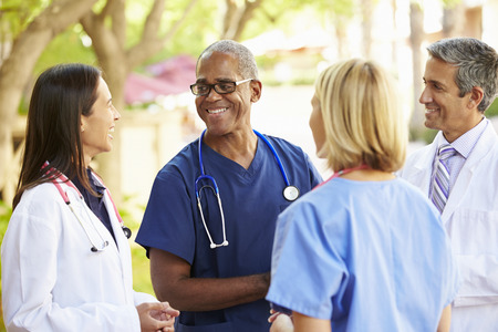 Group of doctors talking outside